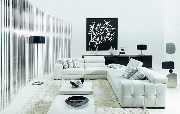 salon noir et blanc avec canapé blanc et mobilier noir comme le ...